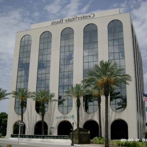 Multi-story building with large long windows with CenterState Bank logo at top of the building